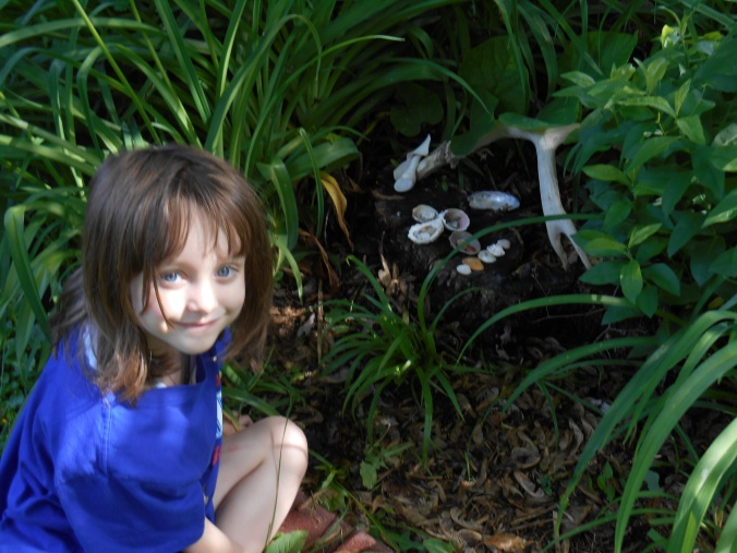 Girl with fairy house